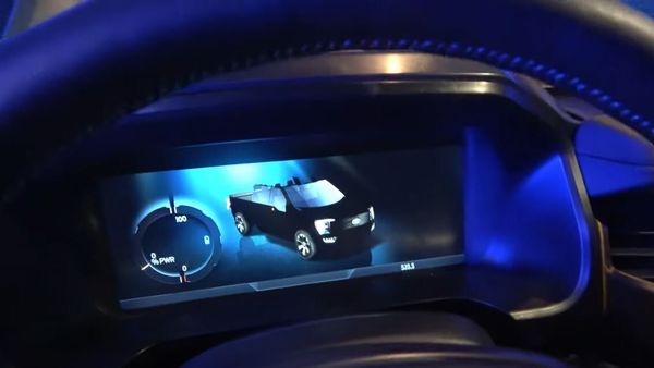 The instrument cluster of Ford F-150 Lightning erroneously shows a convertible version of the electric pickup truck. (Image: Youtube/MrTruck)