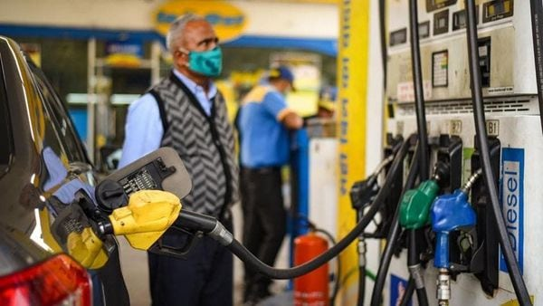 File photo: A man looks at the counter as a vehicles is filled with fuel at a petrol pump in New Delhi, India. (HT_PRINT)