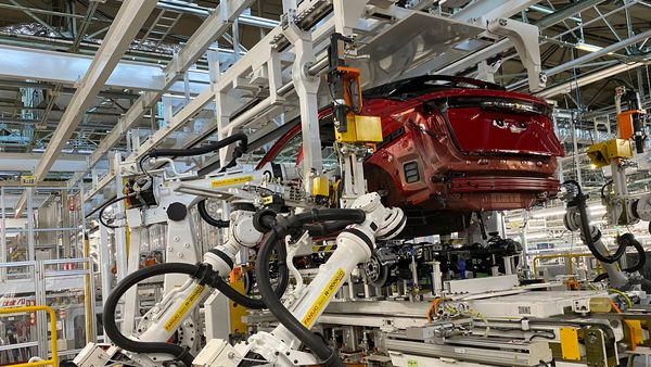 Robotic arms put in the electric vehicle powertrain into the Ariya model in the assembly line at Nissan's Tochigi plant in Kaminokawa town, (AP)