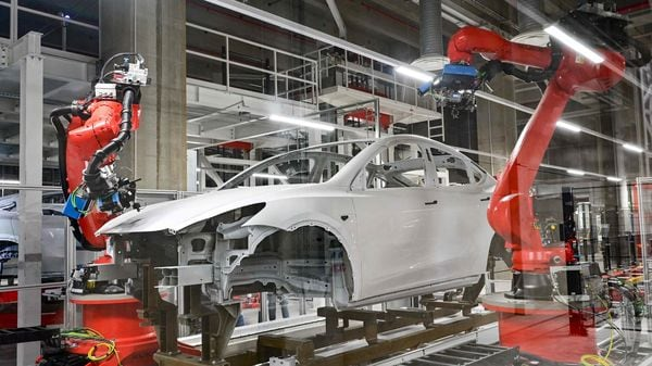 Production of the Tesla Model Y during the opening of the new Gigafactory of US carmaker Tesla in Gruenheide, east of the German capital Berlin. (AFP)