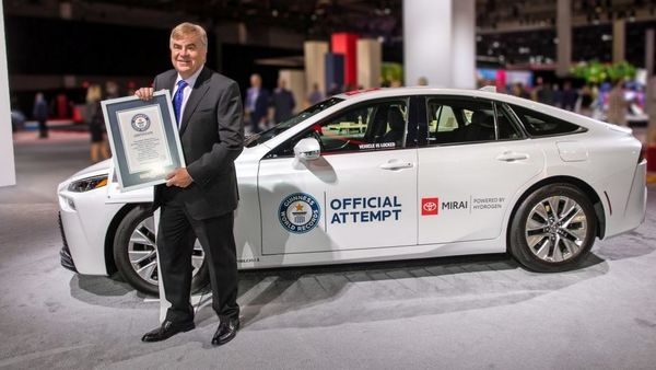 Bob Carter, executive vice president, Toyota Motor North America with the official Guinness World Records certificate. (Toyota)