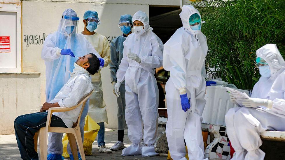 দেশে গত ২৪ ঘণ্টায় করোনায় (Coronavirus) প্রাণ হারিয়েছেন ৩,৮৭৪ জন। ফাইল ছবি : পিটিআই ( PTI)