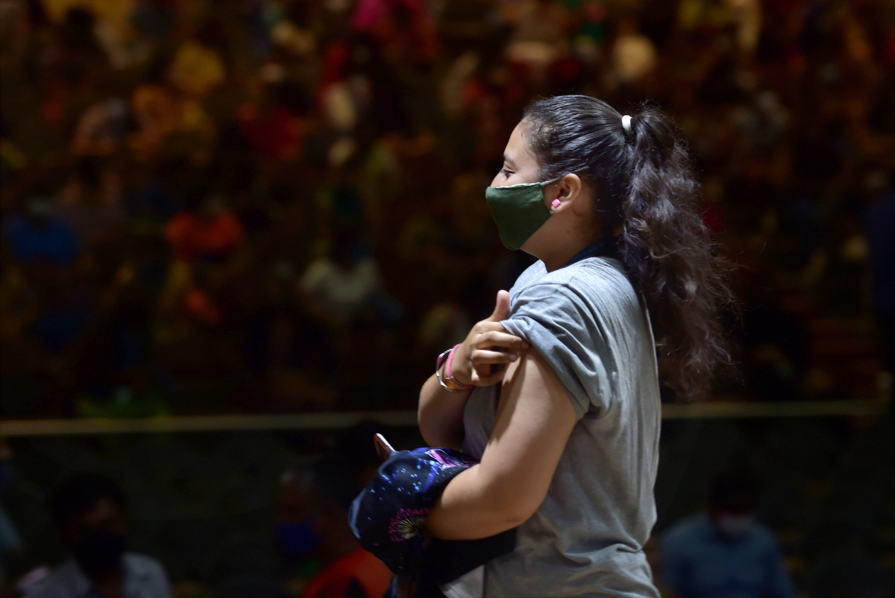 Bengaluru: A student reacts after receiving a dose of COVID-19 vaccine, during the ongoing coronavirus-induced lockdown in Bengaluru, Monday, July 5, 2021. (PTI Photo/Shailendra Bhojak)(PTI07_05_2021_000120B) (PTI)