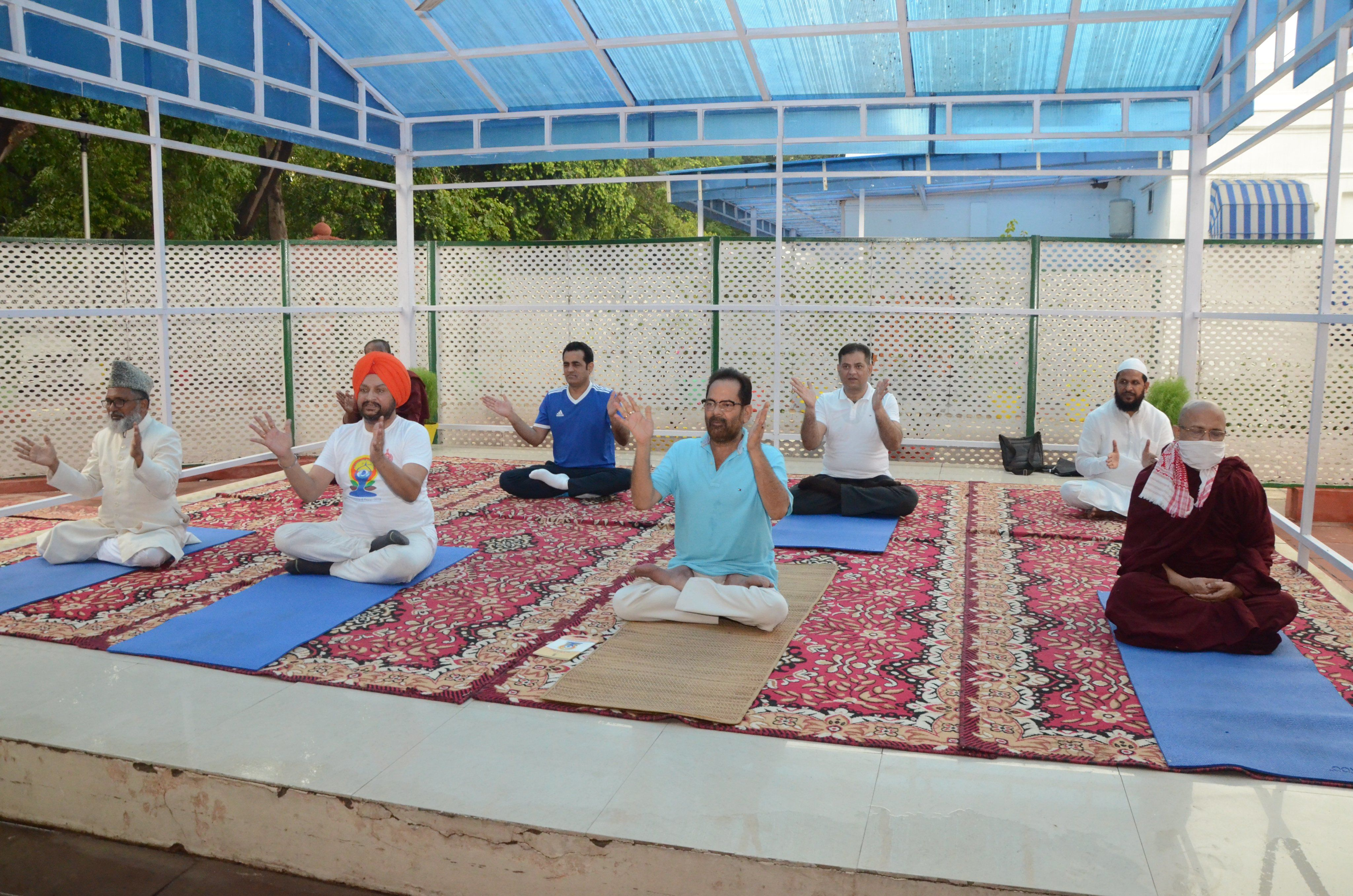 <p>Naqvi performs 'asanas' with people of different communities</p>