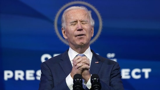 "President-elect Joe Biden speaks at The Queen theater in Wilmington on January 6. Biden called the violent protests on the US Capitol ""an assault on the most sacred of American undertakings: the doing of the people's business.""(Susan Walsh / AP)"