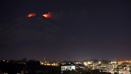Eruptions from Mount Etna light up the sky during the night, seen from Catania, Italy on January 4.(Antonio Parrinello / REUTERS)
