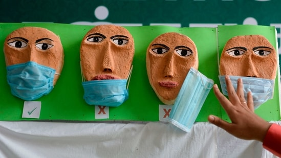 A health worker adjusts a mask on a Covid-19 awareness exhibit during the dry run at a government hospital in Chennai on January 8. The first nationwide mock drill was held on January 2 which, the health ministry said, helped to iron out any glitches in the final execution and further refinement of the operational procedures.(Arun Sankar / AFP)