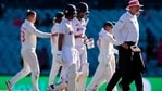 India's captain Ajinkya Rahane (3L) and his teammate Cheteshwar Pujara (C) walk off the field at the end of the fourth day. (Getty)