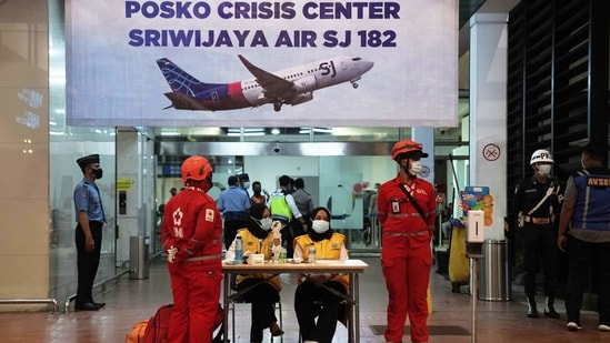 Medics and officials at the flight SJ 182 Crisis Centre at Soekarno-Hatta International Airport in Cengkareng, near Jakarta on January 9. The Boeing 737-500 with 12 crew members and 50 passengers on board was headed to Pontianak in West Kalimantan before it disappeared from radar screens four minutes after takeoff.(Dimas Ardian / Bloomberg)