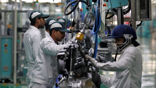 Employees work on an assembly line of Honda Motorcycles & Scootesr India at Vithalapur town in the western state of Gujarat, India,(Reuters)