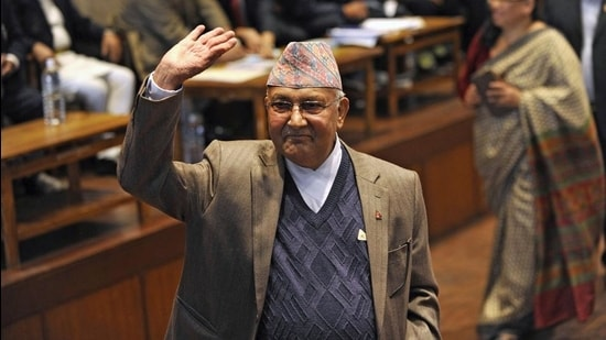 In this file photo taken on October 28, 2015, Nepal's Prime Minister KP Sharma Oli waves after casting his vote in an election for Nepal's new president in Kathmandu. (AFP)
