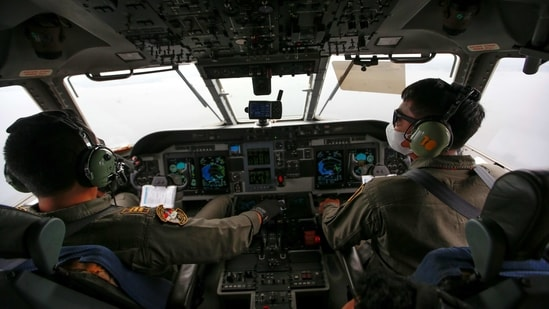 Indonesian Air Force pilots in the cockpit during an aerial search for the Sriwijaya Air SJ-182, in Jakarta on January 10. The search focuses on the outer ring of the Laki and Lancang islands off the Jakarta coast. The sea in this area is about 20 to 23 metres (65-75 feet) deep.(Willy Kurniawan / REUTERS)