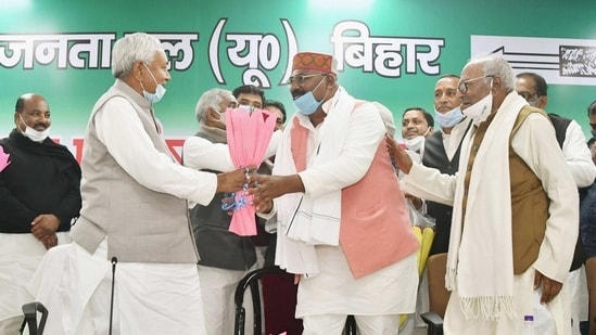 Patna: Bihar Chief Minister Nitish Kumar and JD(U) National President RCP Singh (R) greet newly elected party state President Umesh Kushwaha (C) during the second day of party state council meeting, in Patna.(PTI)