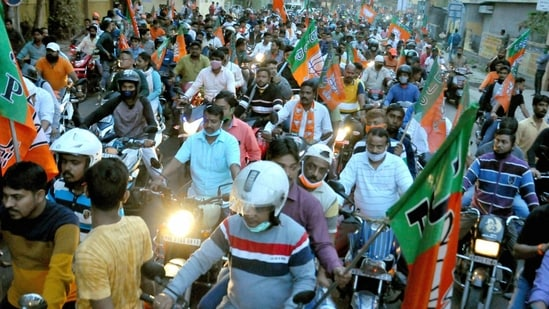 BJP workers participate in a bike rally to protest against the ruling TMC government in Kolkata,(PTI)
