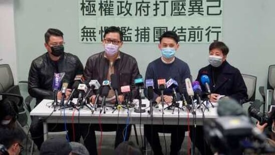 Former Democratic Party legislators Andrew Wan, left, Lam Cheuk-ting, second left, and Helena Wong, right, attend a press conference after being released on bail in Hong Kong. (AP Photo)(AP)