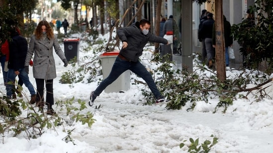 A man jumps over a snow-covered street in Madrid on January 10. The authorities are worried about the prospect of snow turning to ice, with temperatures expected to fall to up to minus 13 (9 Fahrenheit) on January 12.(Susana Vera / REUTERS)