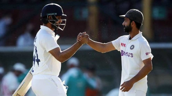 India's Hanuma Vihari shakes hand with skipper Ajinkya Rahane on the 5th day of the third test match between Australia and India, at Sydney Cricket Ground.