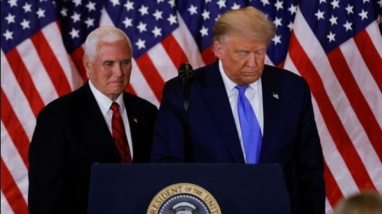 US President Donald Trump and Vice-President Mike Pence stand while making remarks about early results from the 2020 US presidential election in the East Room of the White House in Washington, on November 4, 2020. (Reuters file)