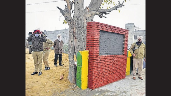Senior police officials inspecting the site where the CM will lay the foundation stone for the Buddha Nullah rejuvenation project in Ludhiana. (Gurpreet Singh/HT)