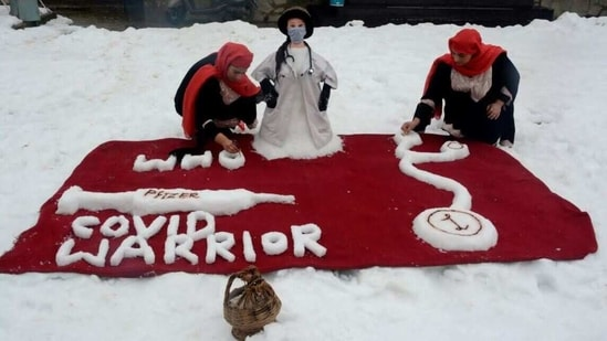 The snow art has models of a lady doctor, a syringe loaded with Covid vaccine, a stethoscope and the acronym of World Health Organisation (WHO).(Twitter)