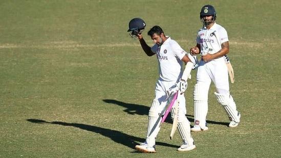 India's Ravichandran Ashwin and Hanuma Vihari walk back to the dressing room after drawing the third Test against Australia at Sydney Cricket Ground(Twitter)