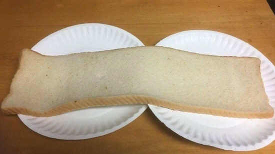 The image shows a horizontally sliced piece of bread. (Twitter/@FLITTER)