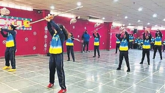 Students participating in the 11th district-level wushu championship.(HT)