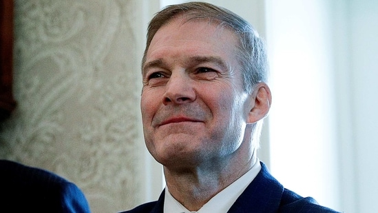 US Rep. Jim Jordan watches as President Donald Trump awards the Presidential Medal of Freedom to US Olympic Gold Medalist wrestler Dan Gable in the Oval Office.(REUTERS)