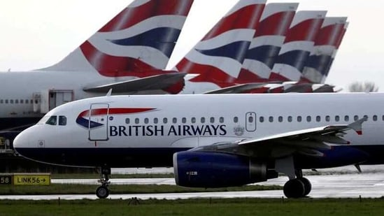 A British Airways plane taxis past tail fins of parked aircraft near Terminal 5 at Heathrow Airport in London, Britain.(REUTERS)