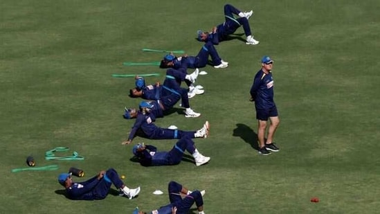Sri Lanka's cricket coach Mickey Arthur (R) walks as team players stretch during a practice session ahead of their second test match with Pakistan at the National Stadium, Karachi, (REUTERS)