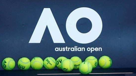 FILE PHOTO: Tennis - Australian Open - Melbourne, Australia, January 14, 2018. Tennis balls are pictured in front of the Australian Open logo before the tennis tournament. REUTERS/Thomas Peter/File Photo(REUTERS)