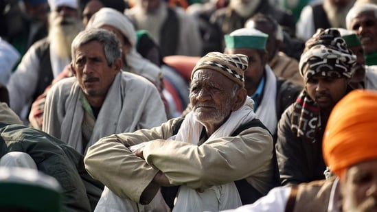 Farmers sit at the site during their ongoing protest against new farm laws at Delhi-Gazipur border, in Delhi on Monday. (ANI Photo)