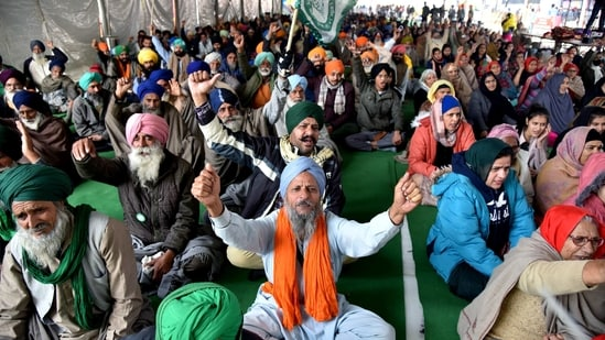 Farmers shout slogans during an ongoing protest against the new farm laws, at the Singhu border in New Delhi on Tuesday.(ANI Photo )