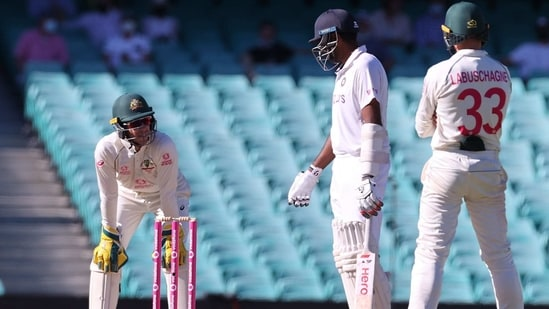 R Ashwin speaks with Australia's captain Tim Paine during the fifth day of the third cricket Test match between Australia and India at the Sydney Cricket Ground(AFP)