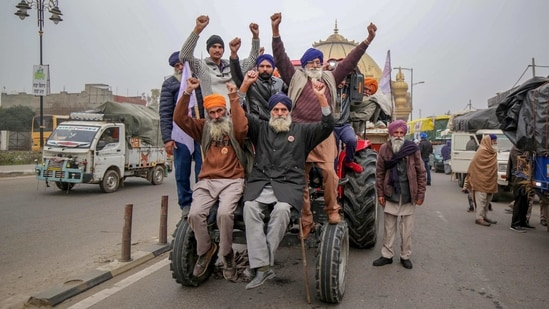 Farmers on their tractor march towards Delhi to join the agitation against the Center's farm laws, in Amritsar on Tuesday.(PTI Photo)