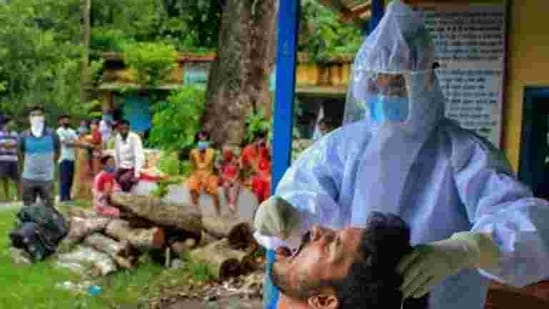 A health worker collects swab sample of a villager for Covid-19 test in Manipur.(PTI)