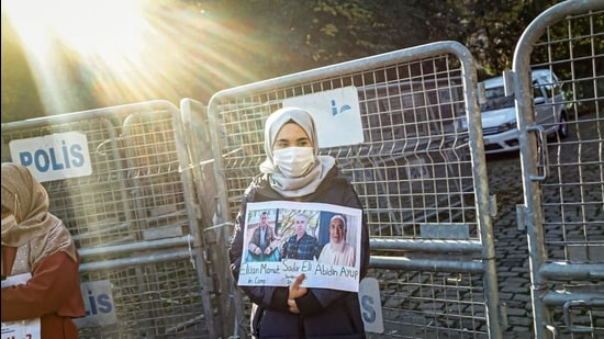 A member of the Muslim Uighur minority holds a placard as she demonstrates in front of the Chinese consulate on December 30, 2020, in Istanbul. (AFP file)