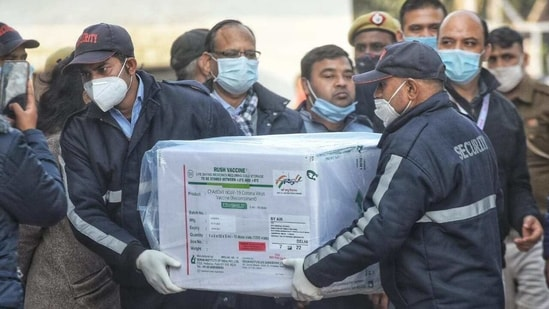 The vaccines were taken in three refrigerated vans under police escort from the airport to the state vaccine store at the Nalanda Medical College Hospital (NMCH). (HT PHOTO)