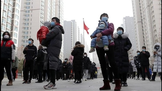 People practise social distancing as they line up for a second round of citywide nucleic acid testing at a residential compound, following new cases of the coronavirus disease in Shijiazhuang, Hebei province on January 12. (REUTERS)
