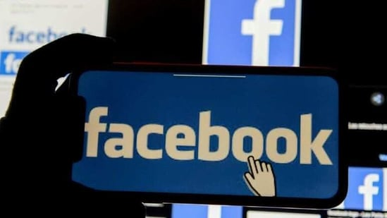 The Facebook logo is displayed on a mobile phone.(Reuters)