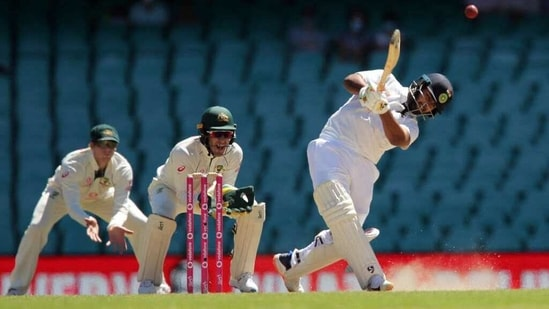 India's Rishabh Pant hits a ball for the boundary on the 5th day of the third test match between Australia and India, at Sydney Cricket Ground on Monday(HT Photo)