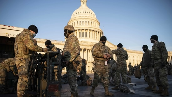 Members of the National Guard are issued weapons outside of the US Capitol in Washington, DC on Wednesday.(Bloomberg)