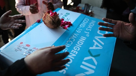 People perform a prayer upon the arrival of the first consignment of Covaxin, in Jaipur on January 13. Bharat Biotech on January 13 also shipped their vaccine against Covid-19, Covaxin to 11 cities.(Himanshu Vyas / HT Photo)