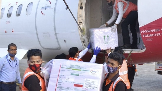 Bhubaneswar: Workers unload from a plane the first consignment of Covishield vaccines, dispatched from Serum Institue of India, at Biju Patnaik Air port in Bhubaneswar, Tuesday, Jan. 12, 2021. (PTI Photo) (PTI01_12_2021_000246B)(PTI)
