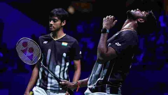 Satwiksairaj Rankireddy(R) and Chirag Shetty of India react after winning a point.(Getty Images)