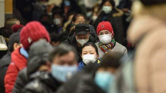 """The health crisis struck just before the Lunar New Year—the most important date of the Chinese calendar, when millions of workers travel across the country to visit family—putting more pressure on the understaffed hospital. """"It takes at least five hours to see a doctor,"""" one woman, who didn't want to be named, told AFP. (Hector RETAMAL / AFP)"""