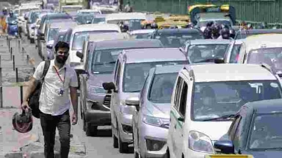 According to officials, around 30 lakh vehicles need to be fitted with HSRPs and colour-coded stickers. Two-wheelers don't need the stickers that identify the fuel type.(HT Photo)
