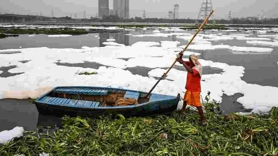 High levels of ammonia in the Yamuna had prompted the Delhi Jal Board (DJB) to reduce or stop water production at its plants at least five times last year.(AFP PHOTO.)