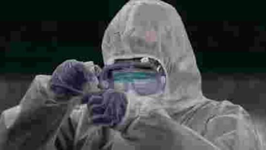 A doctor prepares coronavirus testing for residents. (AP)