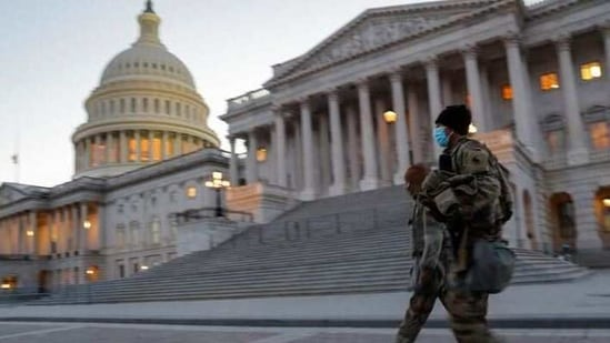 US National Guard members walk near the U.S. Capitol Building on Capitol Hill in Washington.(REUTERS)